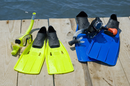 flippers: Colorful flippers on a pier near the ocean