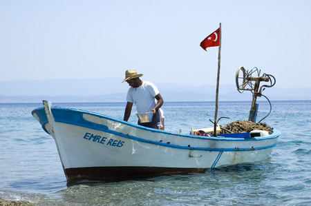aegean: A fisherman selling fish he caught at the Aegean sea