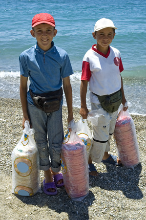 olds: Two happy 13 year olds earning their life by selling halva at the beach to the tourists