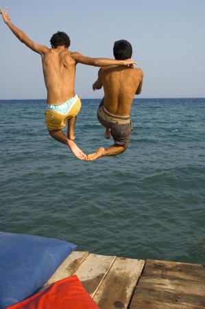 teen feet: Friends having fun at the beach
