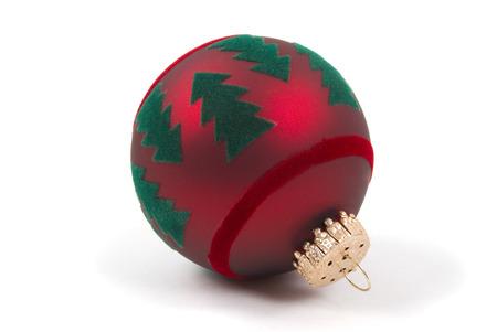 A glass Christmas ornament with felt Christmas trees on it photo