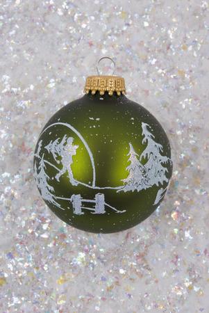 A glass Christmas ornament on snow photo