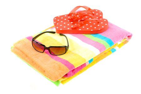 flipflops: Colorful summer beachwear (flipflops), towel, and sunglasses Stock Photo