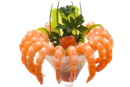 Gourmet large shrimp cocktail with cocktail sauce, lime, lettuce, parsley and chives photo