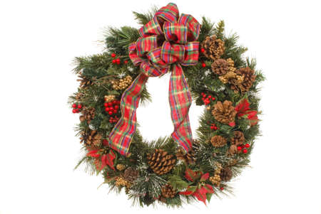 Christmas wreath with pine cones, ornaments, ribbons, poinsettias, berries Stock Photo