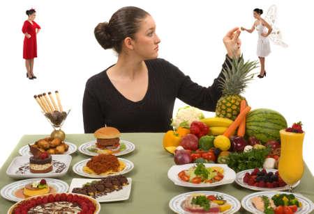 buena salud: Este a�o yo he resolver haciendo caso omiso de mi n�mesis en el arco de opciones culinarias y prestar mucha m�s atenci�n a la voz angelical que me ayuden a cenar con sensatez.  Foto de archivo