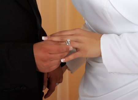 Wedding vows sealed with a ring ( a diamond is forever) photo