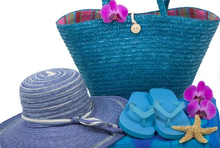 flipflops: Colorful summer beachwear, flipflops, towel, bag, hat, orchids and starfish Stock Photo