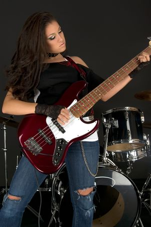 Rock star with beautiful make up playing guitar photo
