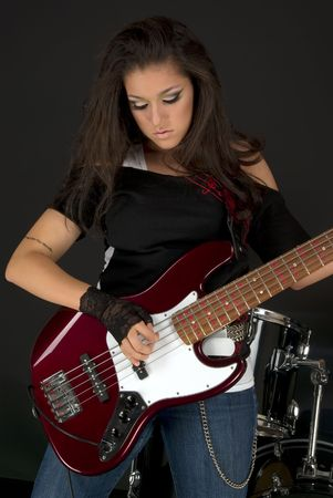 Rock star with beautiful make up playing guitar Stock Photo - 3212679