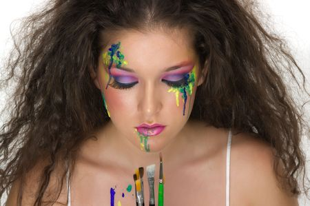 Painter girl with beautiful make up photo