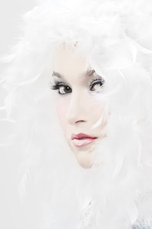 winter fashion: Girl with beautiful make up and white feathers