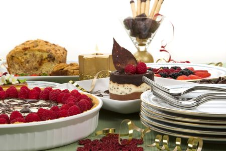 Elegant table with many desserts and fruits (eclair, pecan swirl cake, raspberry pie, cheese cake, creme caramel, and more) Stock Photo - 3682954