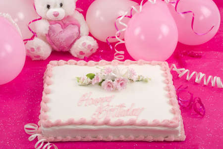 Delicious beautifully decorated bithday cake, teddy bear and balloons photo