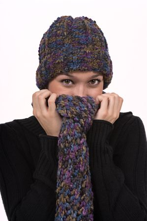 Girl wearing hat and scarf on a cold winter day photo