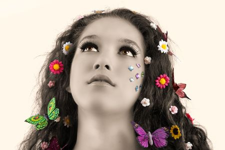 Girl with butterflies and flowers in her hair photo