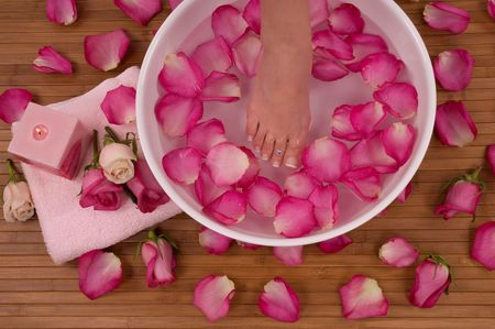 woman in bath: Spa Treatment with aromatic roses, petals, and candle