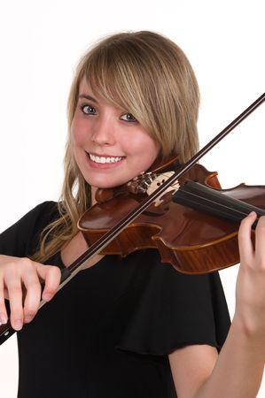 prodigio: Una bella adolescente felice a giocare il suo violino