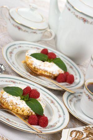 Raspberry tart with raspberry jelly filling, fresh raspberries, mint and coffee   photo