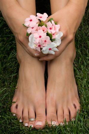 Pedicured feet on grass photo