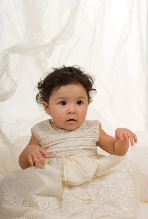 One year old baby girl with a beautiful dress. Stock Photo - 5630625