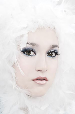 Girl with beautiful make up and white feathers Stock Photo - 6073598