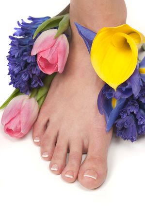Pedicured feet, manicured hands and aromatic flowers in a spa photo