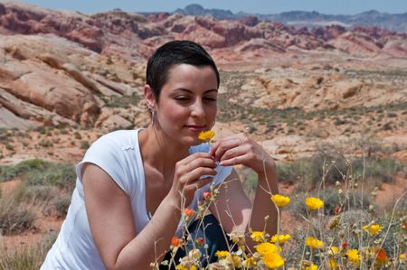 Breast cancer patient enjoying life again after chemo treatment ( wild flowers in the desert) photo
