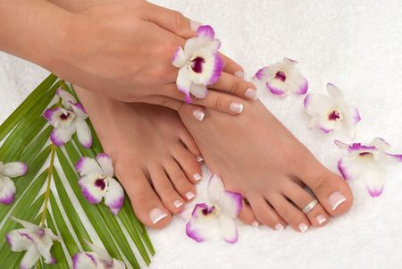 Pedicured feet manicured hands photo