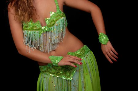 belly dancer: Belly dancer with beautiful green costume Stock Photo