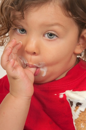 Child eating ice cream photo