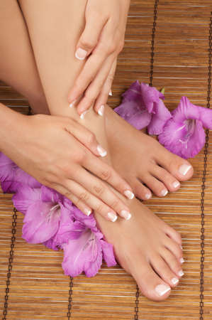 spa pedicure: Pedicure and manicure spa with orchids