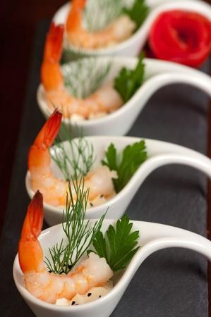 shrimp cocktail: Shrimp appetizers during a party