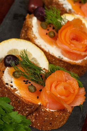 starter: Smoked salmon, capers, cheese and herbs Stock Photo