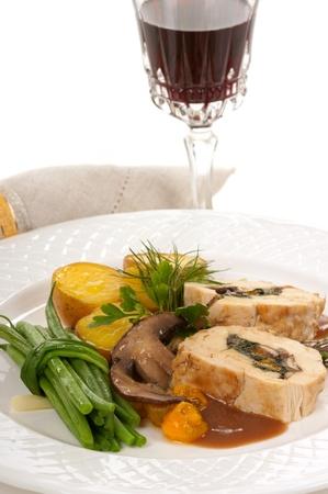 Stuffed chicken, green beans, potatoes, yellow tomatoes, and mushroom Stock Photo - 17627226