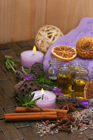 scented candle: Spa concept with lavender, massage oil, aromatherapy items Stock Photo
