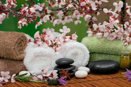 Spa scene with aromatic lavender and towels Stock Photo