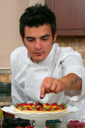 Chef making fruit tarts photo