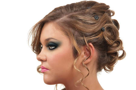 prom: Young woman with beautiful hair do and smokey eye make up Stock Photo