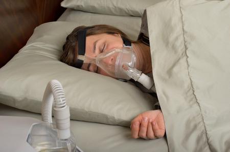 Woman wearing CPAP machine for sleep apnea photo