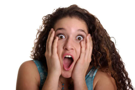 Shocked teenager with naturally curly hair Stock Photo