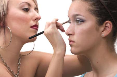 artist's model: Professional make up artist applying make up on a teen model