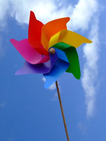 Weathercock in a shape of colorful flower with sky background photo