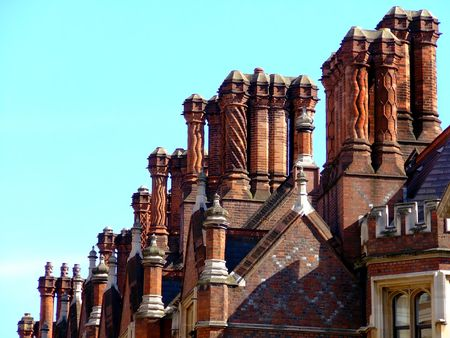 dozens: Red roof with dozens of chimneys and sky in background