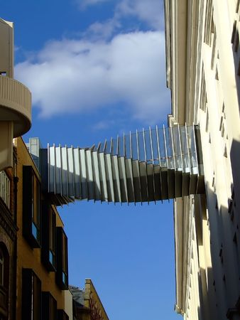 Interesting foot bridge connecting two buildings photo