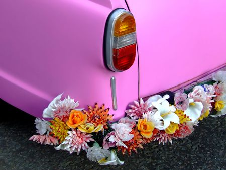 Pink car from rear with flower bumper Stock Photo - 440575