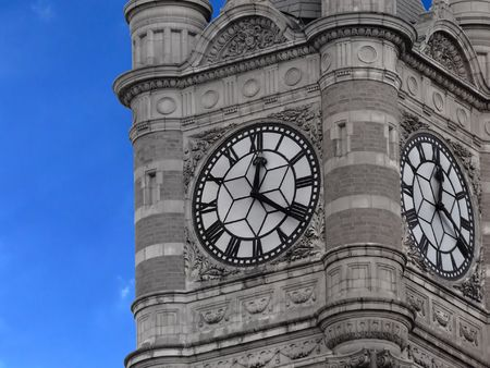 Clock with star shape on a middle on the top of a tower photo