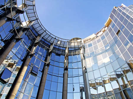 Oval business metal and glass facade building photo