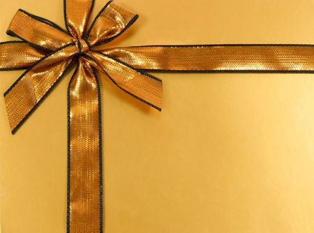 curtsy: Gold gift with shinny ribbon and bow