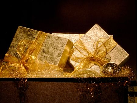 curtsy: Two big silver gift boxes with golden bow